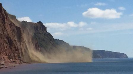 Claire Lewis and Rob Cox were on the beach when the latest cliff fall happened. Credit: Rob Cox Phot