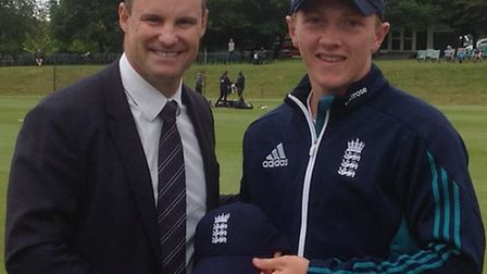 Former England cricket captain Andrew Strauss presenting Dom Bess with his cap