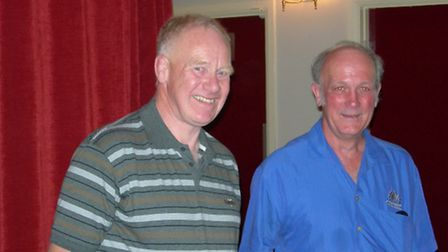 Stewart Hayman with John Richards as they marked his 50th year at Hayman's Butchers