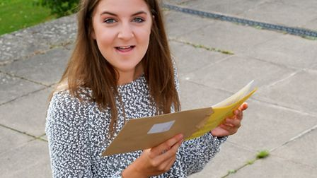 Students from Sidmouth College received their GCSE results. Connie Champain opens her results letter