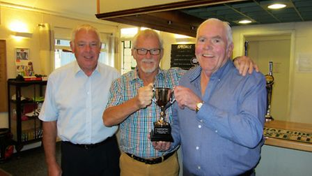 The presentation of the Jurassic Cup with (from left to right) Ray Gunston, Sidmouth Club captain, G
