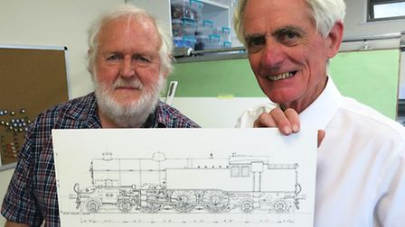 Bob Phelps with one of his model railway engine designs and Peco chairman Michael Pritchard. Picture