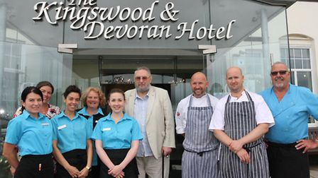 Sidmouth resident Colin Healey is pictured with some of the staff at the Kingswood and Devoran Hotel
