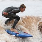 Young surfers making the most of the conditions off Sidmouth this week. Ref shsp 31-16SH 4095. Pictu