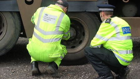Officers and the DVSA inspecting a vehicle during Operation Rogue Trader.
