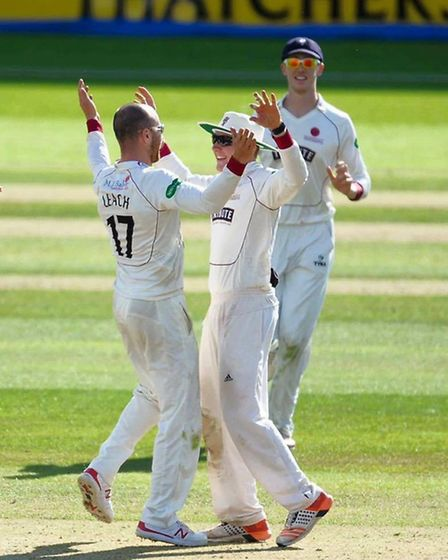 Dom being congratulated by Somerset player Jack Leach. Credit: Somerset Cricket Club