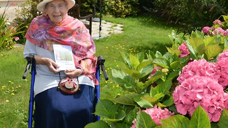 Marjorie Hodnett from Abbeyfield Court with her book of poems, 'A sideways Glance at Life Around Sid