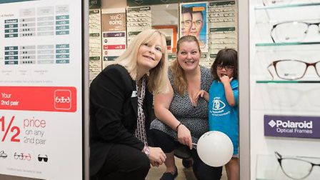Store manager Nicola Harris (left) in the revamped Sidmouth Vision Express store with Rose Elhiti an