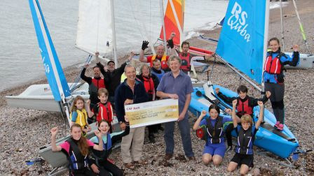 Alan Darrant, chairman of the SVA, presents a cheque to Sidmouth sailing club's Vice-Commodore Alast
