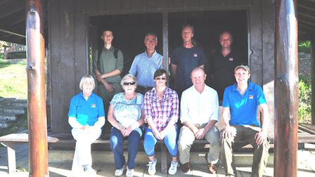 Members from Beer Parish Council, EDDC countryside team and volunteers enjoy the newly restored shel