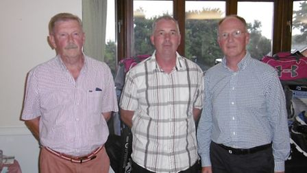 Two of the winning team together with Sidmouth professional Trevor Underwood after a most succesful