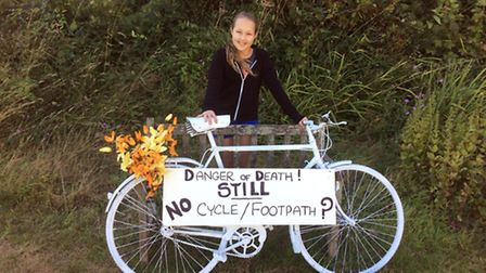 Dominique Webb protesting with her painted bike