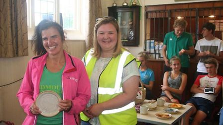 Naomi Garrick receives the Sidbury Fair Open title trophy for the second year running