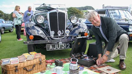 Peter Harris at the Sidmouth chamber of commerce car show. Ref shs 38-16TI 7643. Picture: Terry Ife