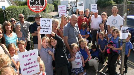 Cathy Debenham with residents protesting about the business park plans. Ref shs 36-16TI 7248. Pictur