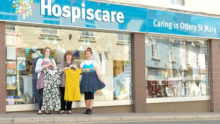 Hospiscare volunteers, Johanna and Sarah, with shop manager, Claire (centre), prepare for Hospiscare