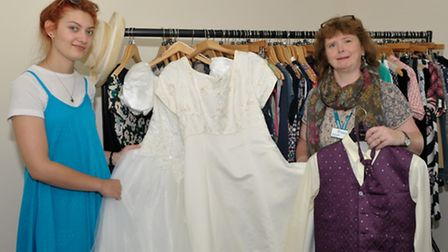 Hospiscare volunteer, Johanna, with shop manager, Claire, prepare for Hospiscare Fashion Show in Ott