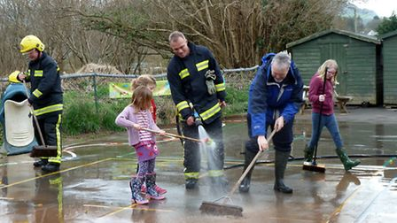 Community clean-up operation after a flood at Tipton Primary School. Picture: submitted