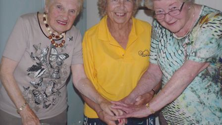 Birthday girls and Sidmouth Living With Cancer members (l-t-r) Joan Petts. Joyce Blackwell and Maure