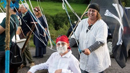 Competitors are left a bit flour-faced after completing one of the challenges in the pram race. - By