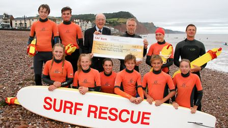 Handel Bennett of the Sid Vale Association presents a cheque to David Manley of the Sidmouth Lifesav