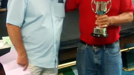 Sidmouth's Bill Cassar receives the cup from Doug Mosedale at Brixham Sea Angling Club