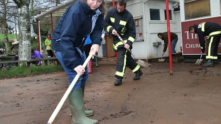 Councillor Claire Wright donned her wellies and helped cleaning the playground at Tipton primary sch
