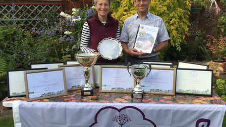 Lynette Talbot and Peter Endersby show off the town's impressive collection of awards from South Wes