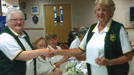 Carol Smith receives her county indoor badge from the county indoor president