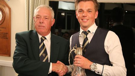 Sidmouth club captain Ray Gunston presents the Claret Jug to Lewis Perry, the victorious Palairet te