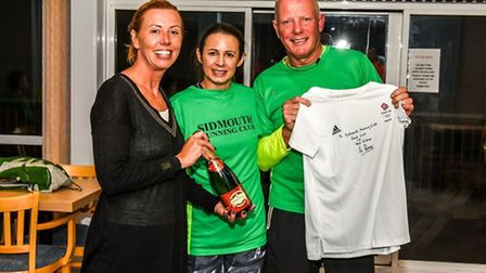 Sidmouth Running Club chairman Terry Bewes receives a signed shirt from Jo Pavey and club vice-chair