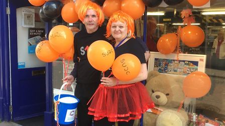 Graham Rossiter and Anne Strudwick from Sidmouth's Cancer Research charity shop raised money for Sta