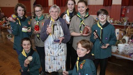 Mary Moore with some of the 1st Ottery scouts at their jumble sale. Ref sho 05-16TI 9936. Picture Te