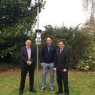 Hugh Griffiths, Stuart Hughes and Christopher Holland with the newly installed weather station.