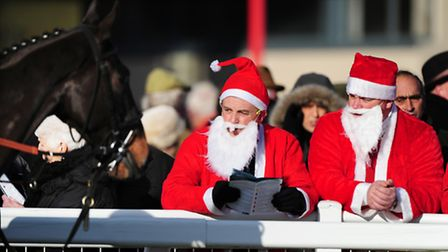 SANTA HAS A DAY AT THE RACES - Race goes get in the Christmas spirt by dressing up as Santa - PHOT