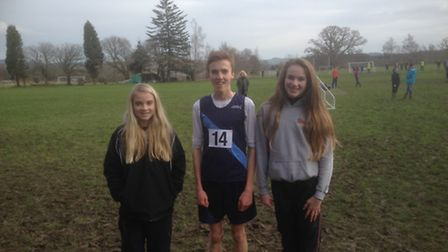 Three Sidmouth Running Club junior members who were involved in the East Devon Schools cross-country