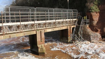 Waves wash up past Alma Bridge on Bank Holiday Monday. Ref shs 13-16SH 9371. Picture: Simon Horn