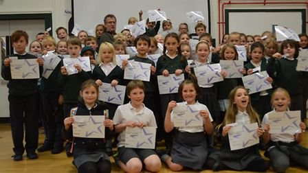 Tickety-Boo's head chef Dave Goldthorpe with all the children who participated in the writing compet