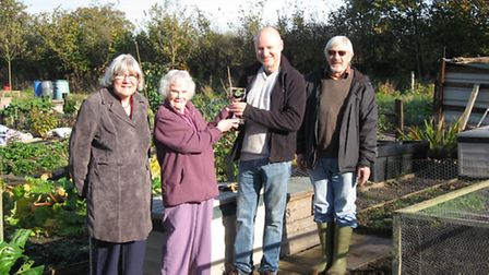 Ottery allotment awards: from left to right: Bob Johnson's daughter Sally and widow Rita with winner