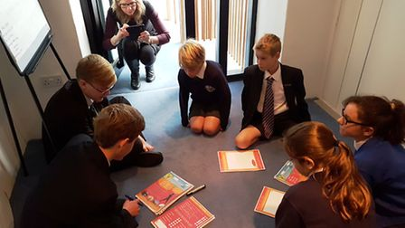 Pupils working on the Neighbourhood Plan surveys aimed at youngsters with Councillor Louise Cole