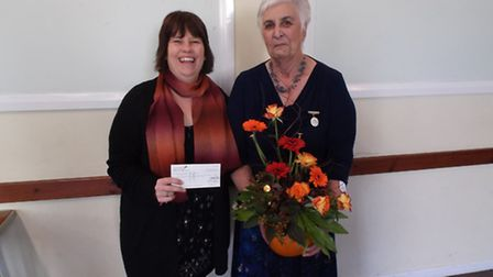 Sheila Baker, the chairman of the Sidmouth Flower Arranging Club (right) presented a cheque to Lynds