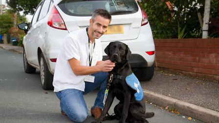 Ashley Leeds with his guide dog puppy Trekka. Ref shs 44-16TI 1187. Picture: Terry Ife