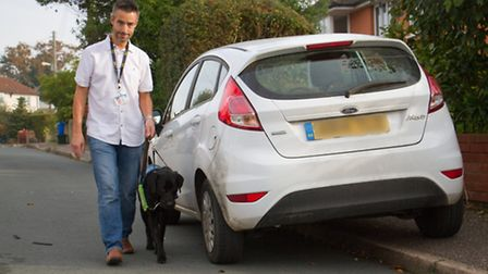 Ashley Leeds with his guide dog puppy Trekka. Ref shs 44-16TI 1184. Picture: Terry Ife