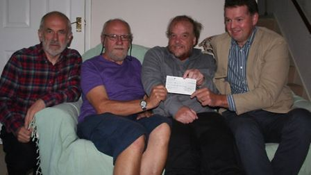 Members of Ottery Community Theatre handed a cheque for £411 to a representative from Cancer Lifelin