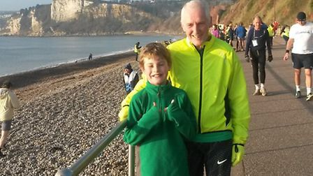Sidmouth Running Club member Rob Edwards with his grandson Stanley. Picture: CONTRIBUTED