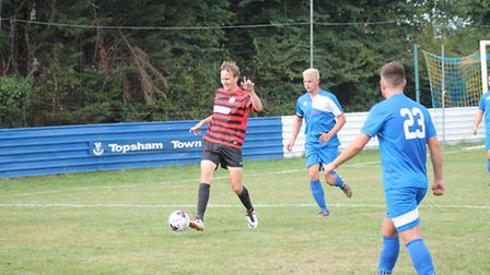 Scott Hughes (in red) in action for Sidmouth Town.