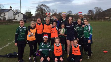 Sidmouth U13 girls with England U20 player Hannah Luff who took the final training session before Ch