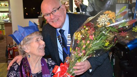Mayor Glyn Dobson presents flowers to Betty Williams who came to the council about the event in 2014