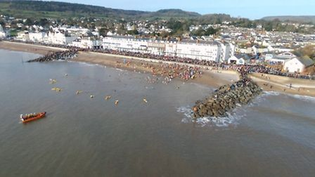 The Sidmouth Boxing Day swim, captured by Robert Pearson's drone. Ref shs Sidmouth swim RP-1. Pictur