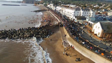 The Sidmouth Boxing Day swim, captured by Robert Pearson's drone. Ref shs Sidmouth swim RP-3. Pictur